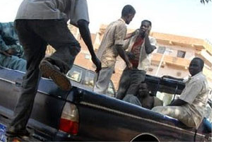 Men climbing onto car