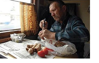 Russian man sharing his feast