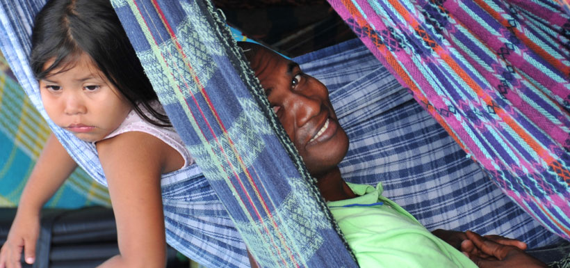 Young girl and woman in colorful hammock