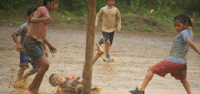 Achuar kids playing soccer