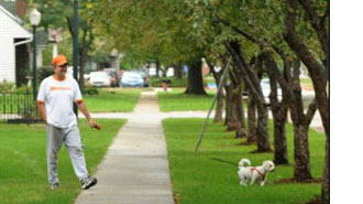 Man walking dog in Fremont, Nebraska